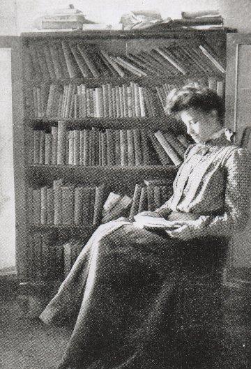 Winnifred Eaton sitting and reading. I